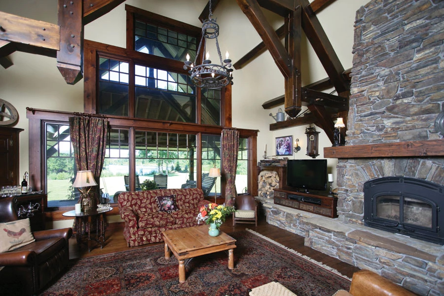 Timeless Trends For Timber Frame Homes - Custom Timber Frames on home stairway designs, home loft designs, home study designs, home man cave designs, home office designs, home fireplace designs, home walk in shower designs, home workshop designs, home foyer designs, home business designs, home deck designs, home porch designs, home entrance way designs, home bar designs, home garage designs, home studio designs, home patio designs, home pantry designs, home library designs, home great room designs,