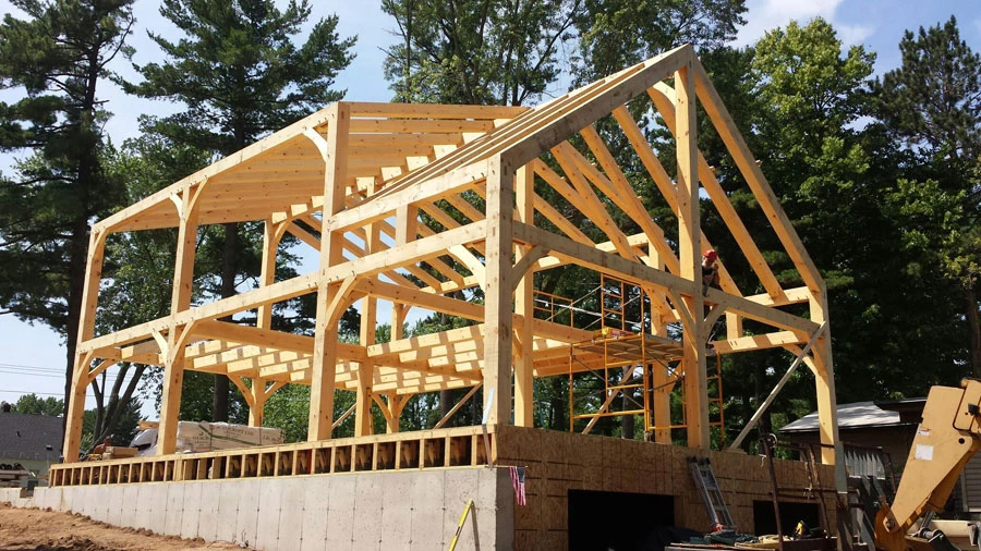 Timber frame home builder and contractor custom timber for Timber frame farmhouse plans