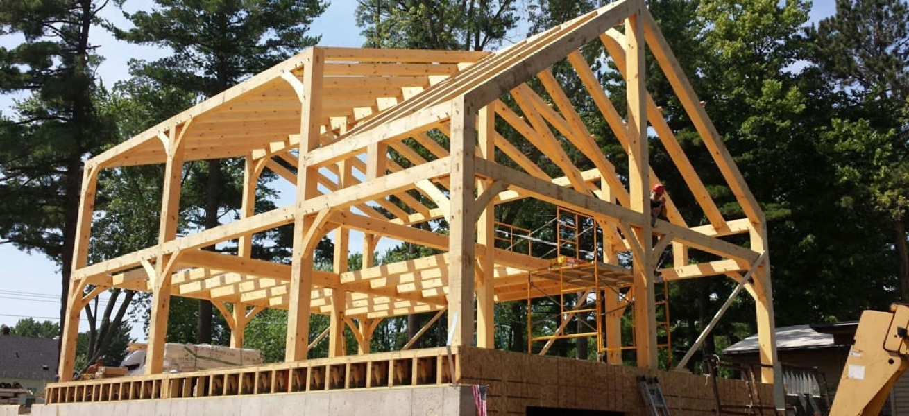 What\'s the difference between Log Homes and Timber Frame Homes ...